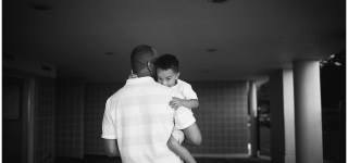 BW Image of Dad holding small boy in his arms OOB Maine