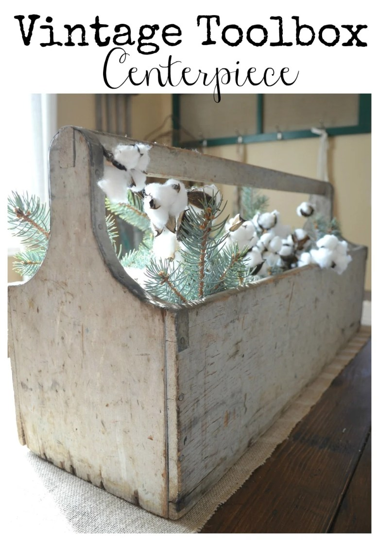 Vintage wooden toolbox used as centerpiece on farmhouse table