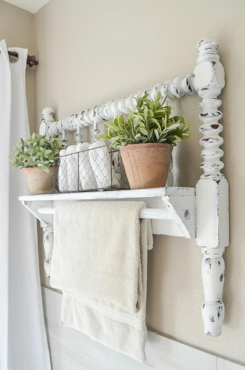 DIY towel bar from Jenny Lind bed frame. Great farmhouse style bathroom decor idea!