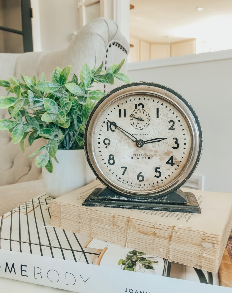Vintage farmhouse style decor. Antique alarm clock.