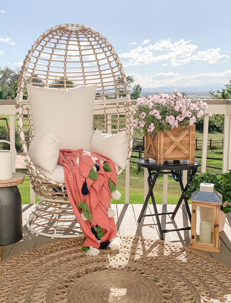 Boho Style Patio with Egg Chair. Cute outdoor summer decor!