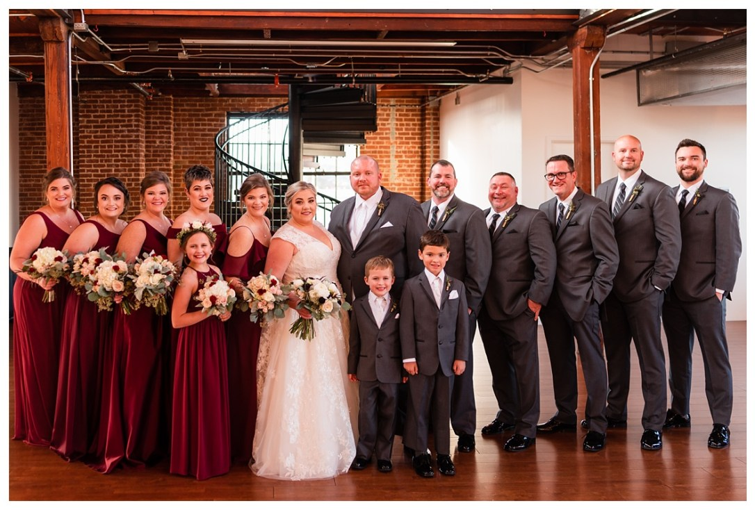 Bridal party dressed in purple and grey