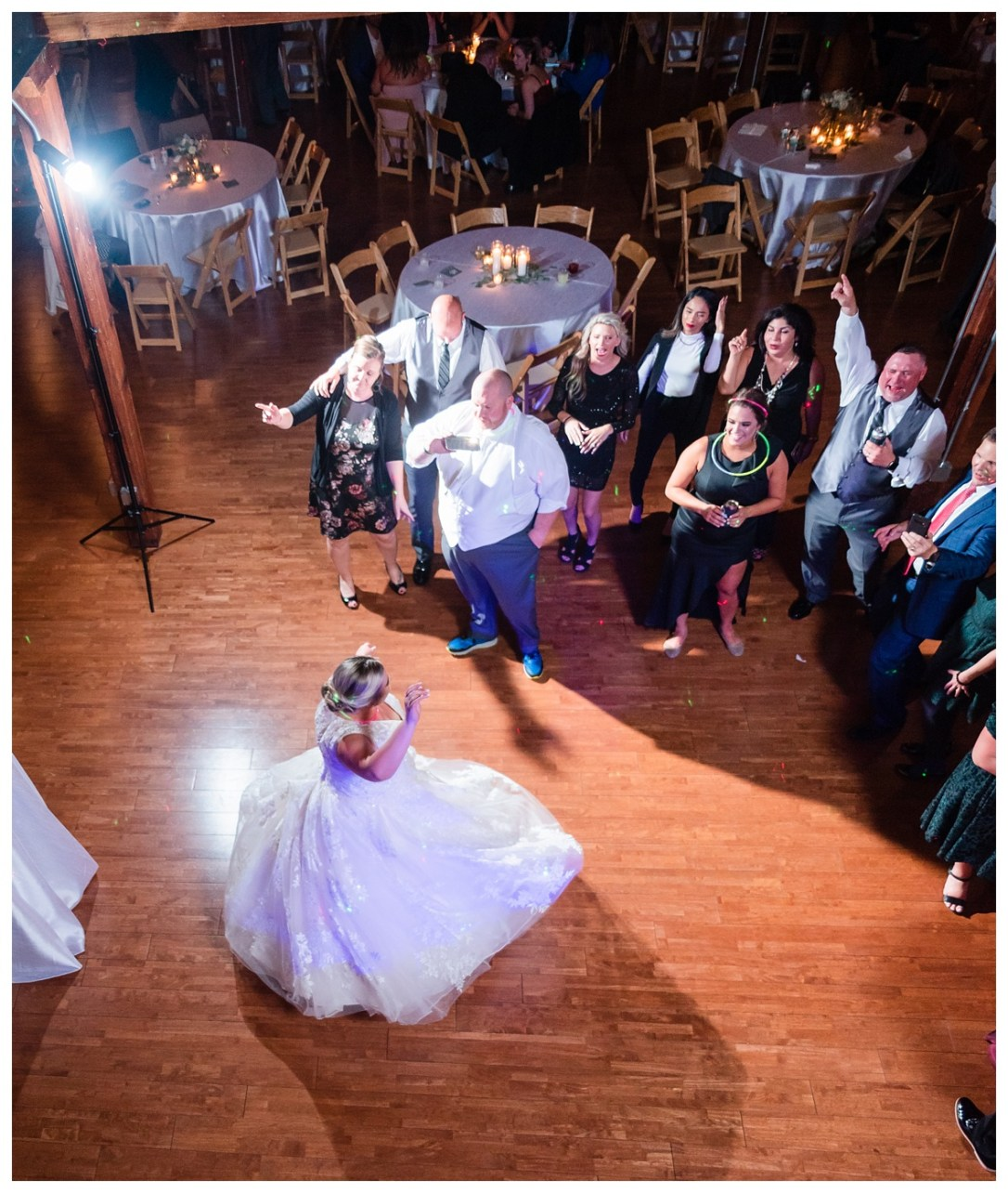 bride dances as groom films her