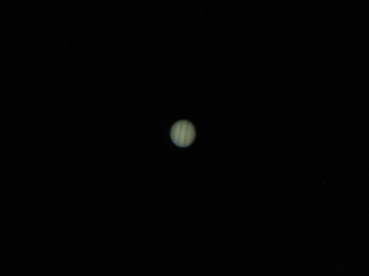 Jupiter through a telescope eyepiece