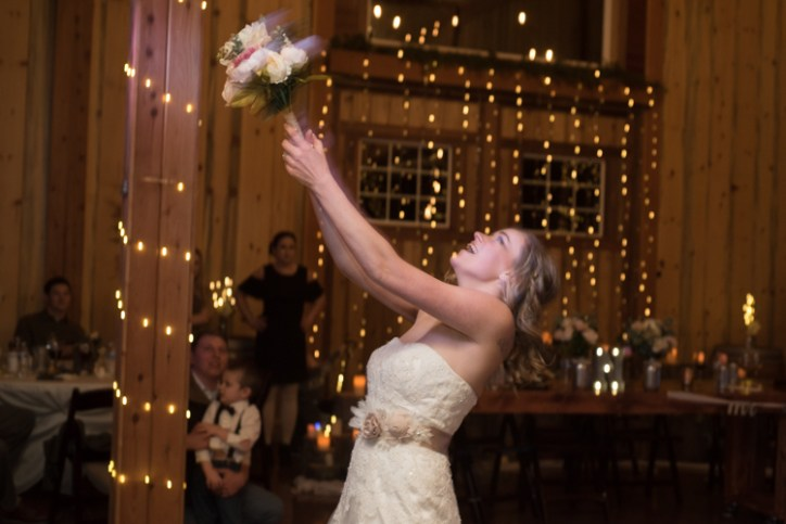 A bride throwing her bouquet