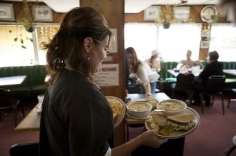 Sarah Serving Tables at Restaurant