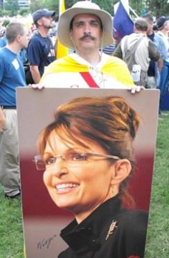 912 March - Man Holding Sarah Palin Photo