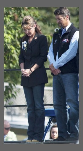 Alaska Governor Sarah Palin and her husband Todd is pictured during an invocation before delivering her final address as the Governor at the annual Governor's Picnic in Fairbanks