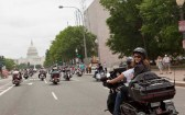 Sarah looks back as she rides toward Capitol with Rolling Thunder
