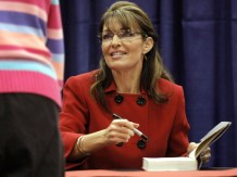 Sarah Signing Her Book - red jacket