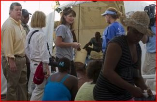 Sarah with Greta and husband in Haiti