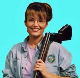 Sarah with gun on shoulder 2