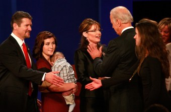 Todd reaches to shake Bidens daughters hand as Biden and Sarah square off - Willow holding Trig