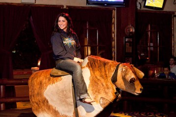 Bristol sitting on mechanical bull