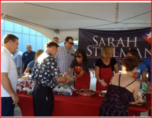 Sarah and Steelman serve BBQ at Steelman rally