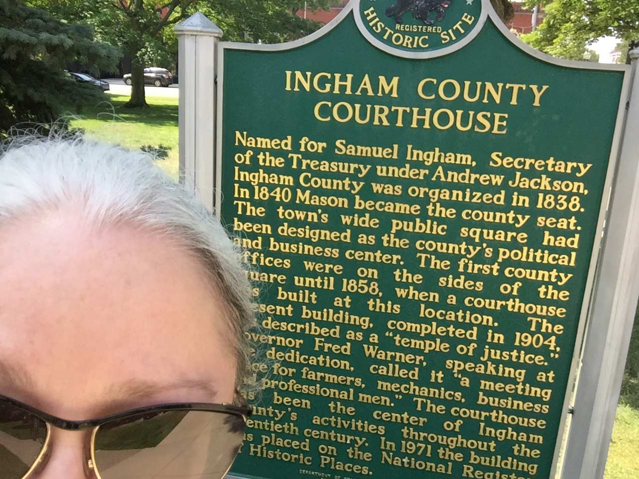 sarah in front of historical site sign: ingham county courthouse
