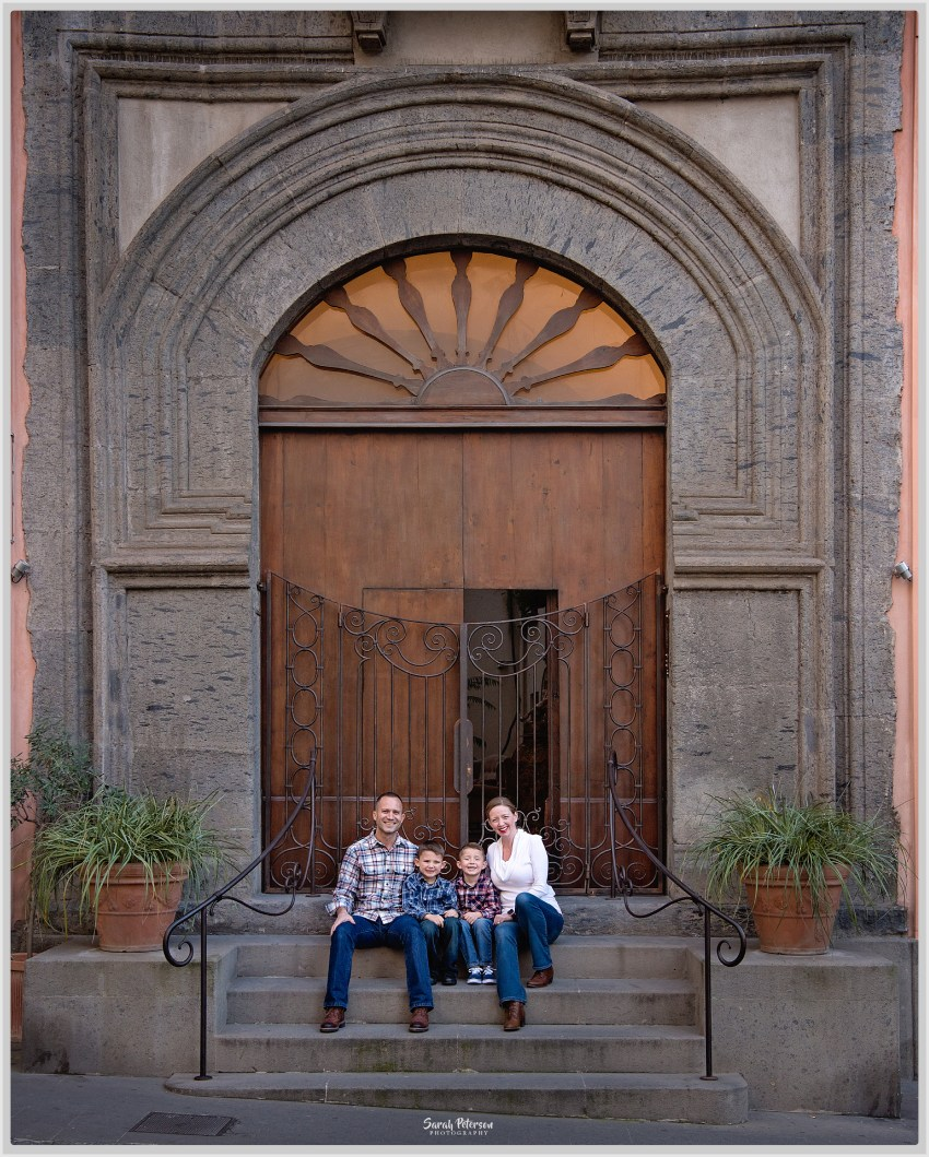 Family in Sorrento italy sitting on steps in front of a church