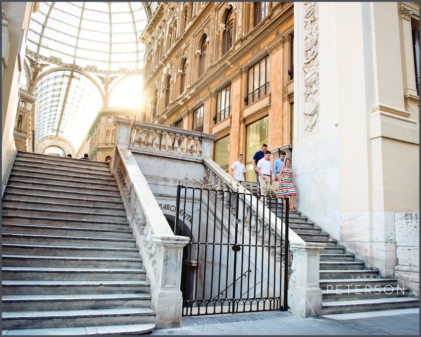 family walking down steps in Galleria Umberto Naples Italy