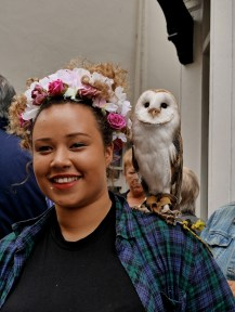 Barn Owl and woman with flower garland on her head