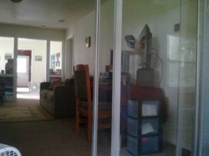 The sliding glass doors separates the enclosed porch and the living room.