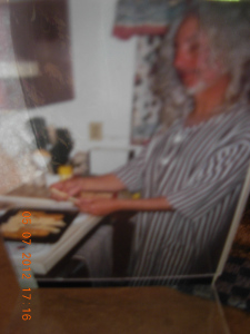 Danny wearing his nightshirt.....creating our supper in the middle of the night at his house in Haines City. 2004