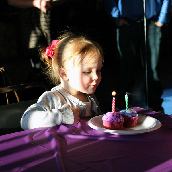 Niece Blowing Out Birthday Candles