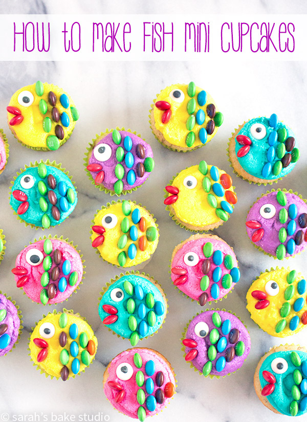 How to Make Fish Mini Cupcakes – dress up your mini cupcakes with colorful buttercream, royal icing eyes, and mini M&M's candies to create a fun and delightful sea of mini cupcake fish!