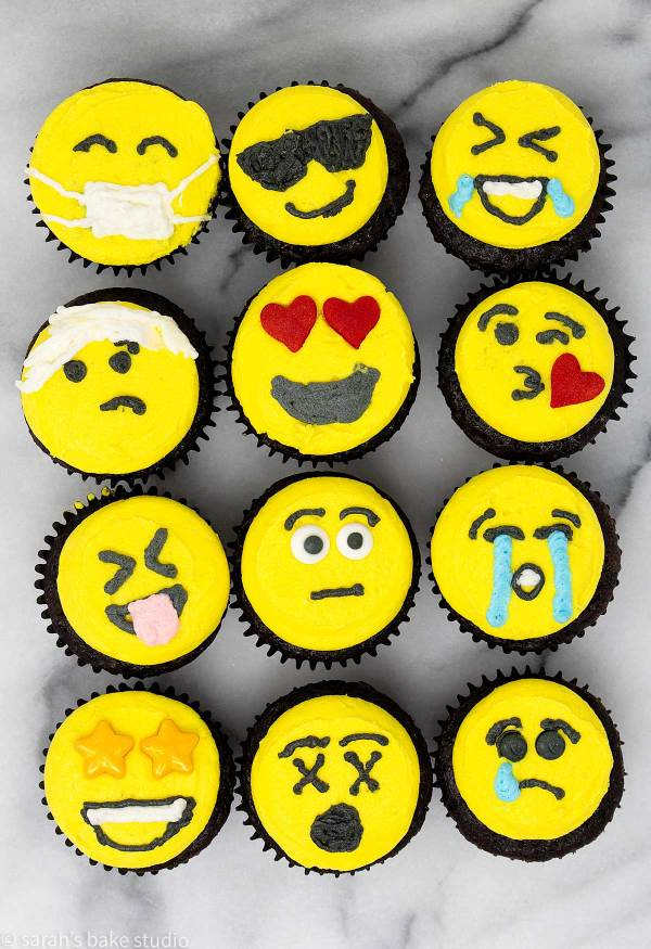 Emoji Mini Cupcakes - get emotional with these cute mini cupcakes adorned with bright yellow emoji faces.