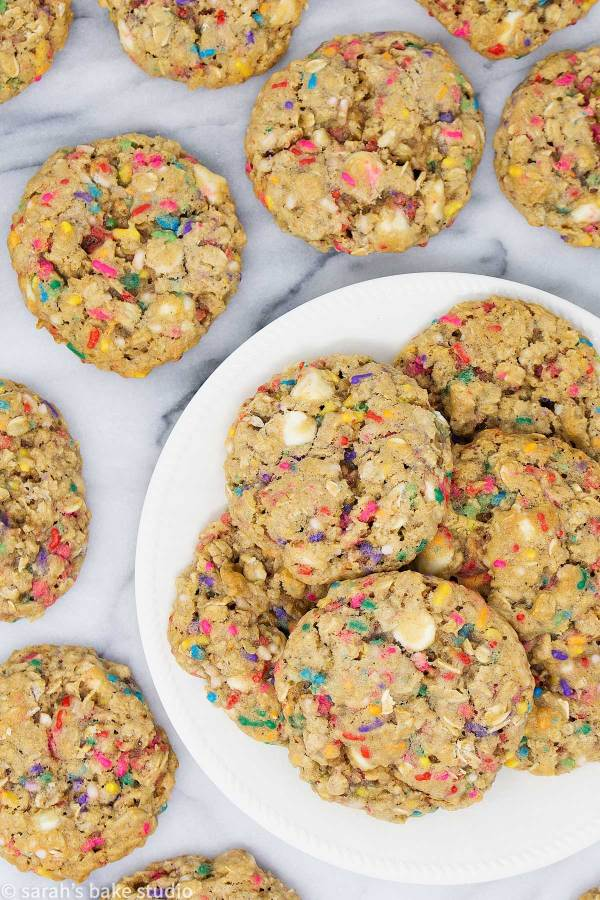 Funfetti White Chocolate Chip Oatmeal Cookies - simply the BEST soft and chewy homemade oatmeal cookies stuffed with white chocolate chips and colorful sprinkles that you'll ever bake and eat!