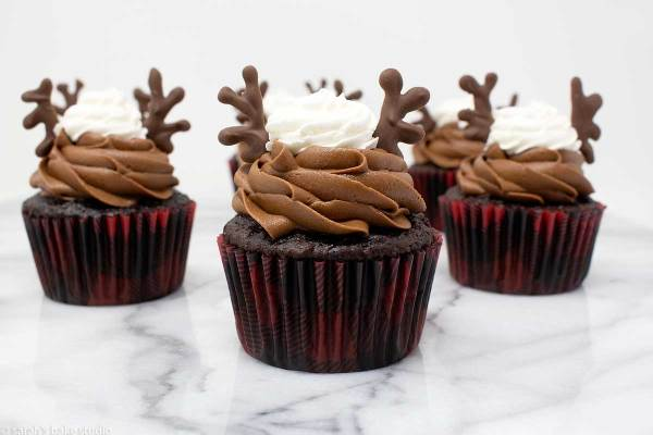 Antler Cupcakes - your favorite chocolate cupcake recipe piled high with chocolate and vanilla buttercream and adorned with homemade chocolate antlers; a positively perfect woodland creatures cupcake.
