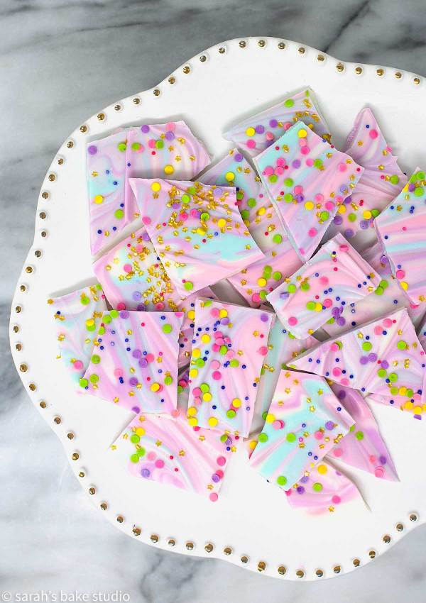 White Chocolate Unicorn Bark - colorful, melted white chocolate swirled together and topped with copious amounts of sprinkles make this unicorn inspired white chocolate magnificent fun and magically delicious.