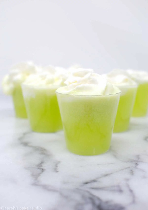 Scooby Doo Pa Pa Shots - coconut rum, banana and melon liqueurs, pineapple juice, and whipped cream make these deliciously tropical green shots muy bueno.