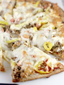 Pizza with pulled pork, cheese, and banana peppers