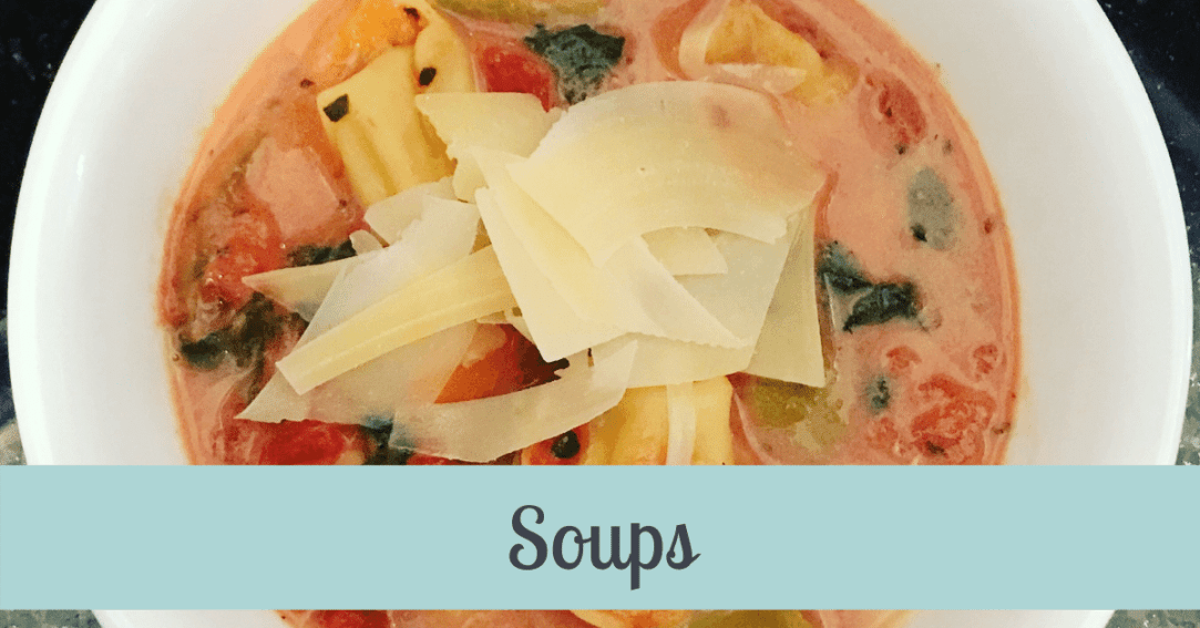 Bowl of tomato soup with tortellini topped with shaved parmesan cheese. Text across the image says Soups.