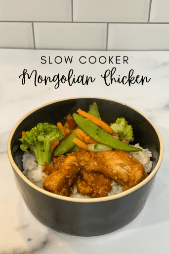 Bowl of white rice with chicken, broccoli, carrots, and snap peas. Text over the image says Slow Cooker Mongolian Chicken.
