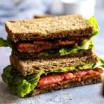 Vegan BLT sandwich cut in half.
