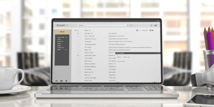 Emails list on a laptop screen isolated on an desk, office background. 3d illustration