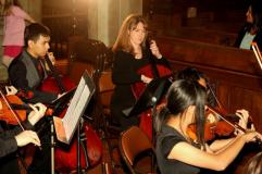 Anne, performing with students of CYMG