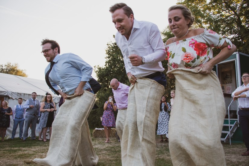Wedding guest sack race. Why you need a professional wedding photographer