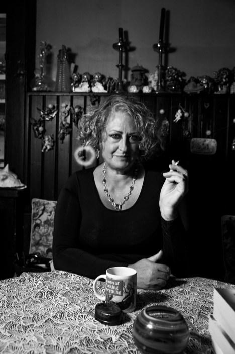 woman blowing a smoke ring