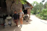 Me and the mother of the family, she has 7 kids. The thatched house behind us is for cooking and eating and lounging.