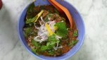 Assam laksa noodle soup. Assam means tamarind. Topped with mint, shallots, pineapple, crunchy fried tofu bits.