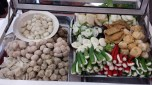 Fish balls, veggies stuffed with fish paste. You pick your own and they drop it in boiling soup to parboil.