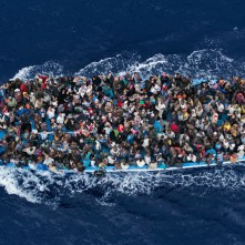 Operation Mare Nostrum. Shipwrecked aboard a boat are rescued 20 miles north from Libya by the frigate FREMM Bergamini of the Italian Navy