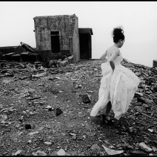 TAIWAN. Taipei County. 1998. Walking across ruins of a deserted factory in northern Taiwan, this prospective bride seeks an alternative backdrop for her wedding album.