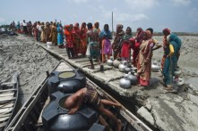 Potable water is delivered by barge to a cyclone affected area.