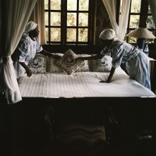 Maids prepare a room for a guest in a wealthy Kenyan household. 2011 Guillaume Bonn