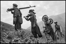 00832_12, Afghanistan, 1980, AFGHN-13284. CAPTION: Mujahideen Carry Parts of a Russian Anti-aircraft Gun. Afghanistan, 1979. pg 9 Untold, The Stories Behind the Photographs. Untold_book Final print_Zurich MAX PRINT SIZE 40x60 retouched_Sonny Fabbri 4/27/2015 NYC144223, MCS1980002W13284