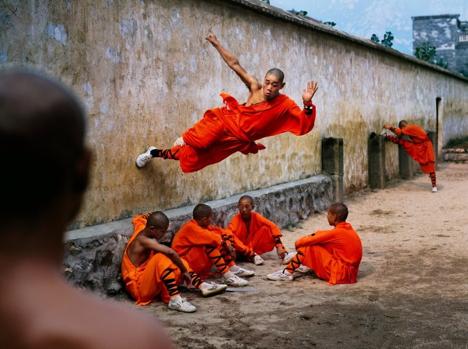china-10038nf3_a-young-monk-runs-along-the-wall-over-his-peers-hunan-province-china-2004-steve-mccurry-web