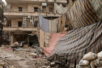 Sheets are used to obscure soldiers of the Free Syrian Army, F.S.A, from the view of Bashar al-Assad's security force snipers.